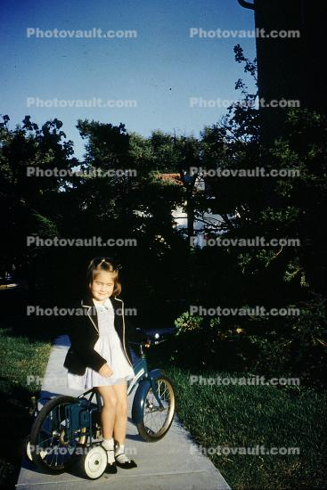 Girl, Training Wheels, Bicycle, smiles, 1960s