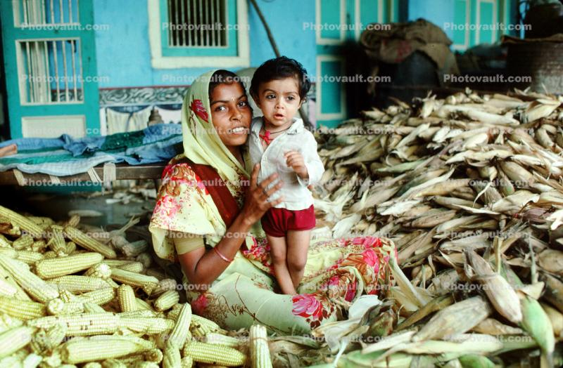 Mother and her boy, son, corn, husks, shucking corn, Gujarati, India