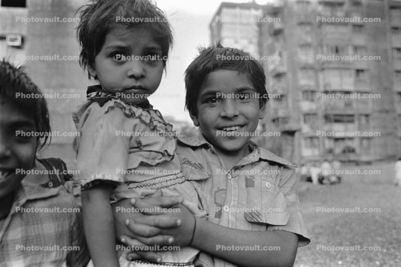 brother and sister, smile, boy, girl, slums, shacks, shanty town, Mumbai, India