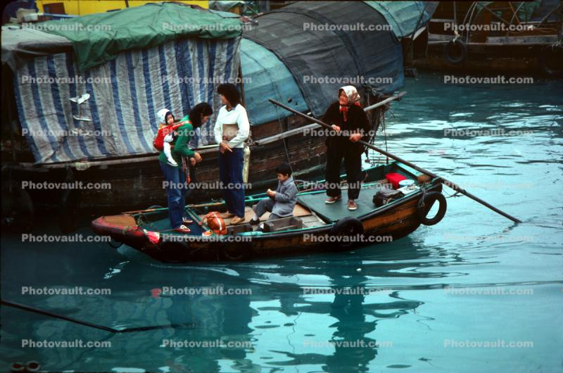 Women, children, grandmother, boat people, harbor