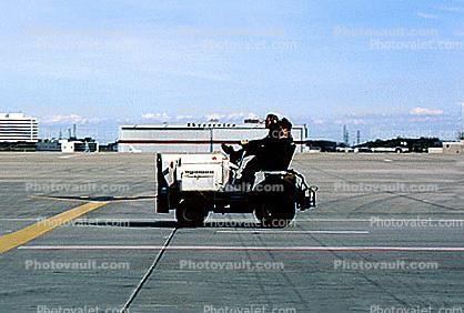 ground personal, baggage tractor