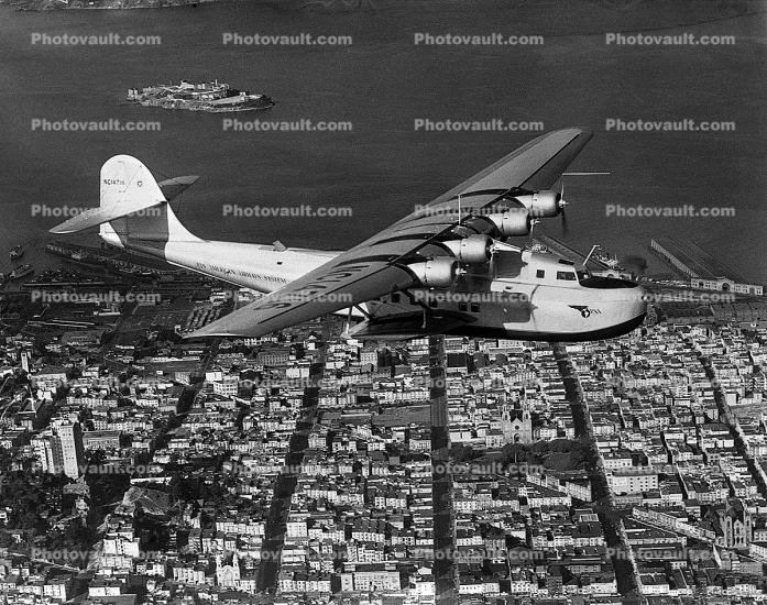 NC14716, Martin M-130, China Clipper flying over downtown San Francisco, 1930's, Pan American Airways PAA, milestone of flight