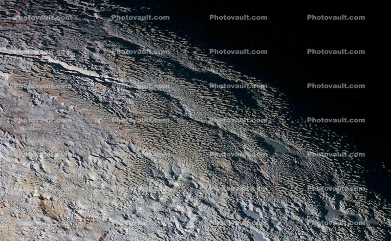 The Tartarus Dorsa Mountains Rise Up Along Pluto, snakeskin texture