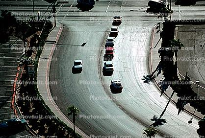 intersection, palm tree shadow, cars, curve, Las Vegas