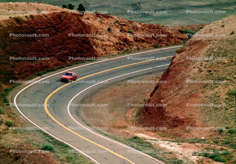 Car Driving on a Lonsome Highway near Vermilion Cliffs Arizona, Road, Roadway, Highway