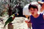 Girl, Touch Exhibit, hands-on, parrot