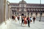 Palacio Nacional (National Palace), sidewalk, woman, man, dress, suit, government building, couple, Zocalo, CBLV01P04_11