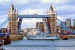 HMS Belfast (C35), Royal Navy light cruiser, Tugboat, Tower Bridge, London, River Thames, CEEV04P01_04.2583