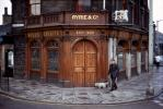Ryrie's Bar, Ryrie & Co., Edinburgh, Man walking his dog, sidewalk, curb, doorway, windows, Scotland, CEEV05P01_17