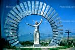 Female Steel Monument, sculpture, memorial, outstretched arms, woman, dress, Round, Circular, Circle
