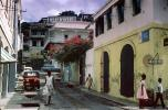 Ad Lib Book Center building, Jeep, houses, street, cars, bougainvillea flowers