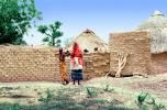 Women in colorful dresses, Grass Thatched Huts, Adobe Wall, Dori, Sod, CJFV01P01_15