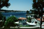 Docks, Sailboats, Homes, Lakeshore, Lake, water, buildings, Mission Viejo, CLAV06P10_04