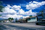 Clouds, cumulus, buildings, shops, Highway 395, cars
