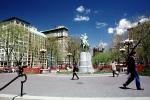 George Washington equestrian statue, horse figure on intergral plinth, pedestal on plinth, Union Square Park, buildings, statue, spring, springtime, trees, Manhattan, CNYV01P14_06