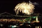 Fireworks, Boats, piers, string of pearls, the Embarcadero, 50th anniversary party celebration for the Bay Bridge