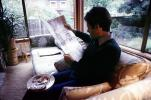 Man reads the morning newspaper, ENCV01P03_04
