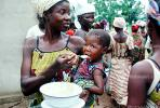 Mother Feeding a Child, Well Baby Clinic, FDJV01P02_04
