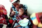 Mother Feeding a Child, Well Baby Clinic, FDJV01P02_06