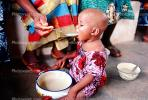 Mother Feeding a Child, Well Baby Clinic, FDJV01P02_09