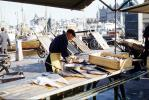 Fresh Fish, seafood, man cleaning fish, FGEV01P10_03
