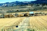 Hay Bale Stacks, Shack, Shed, barn, mountains, dirt road, path, gate, fence, FMNV05P01_03