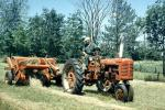 old time Tractor, Farmer, Farmall, Baler, Hay Bale, Baleing Hay, Windrows, FMNV09P01_01
