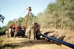 Crane, Tractor, Laying down Water Pipe, Pipline, Ditch, Africa, FWPV01P01_07