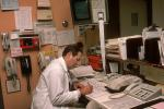 Doctor late at night, telephone, rolodex, file folders, HEPV01P05_03