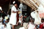 Nurse, Weighing a Toddler, Well Baby Clinic, Rushinga Zimbabwe, HOFV01P05_06