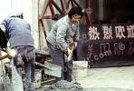 Woman mixing cement, Shanghai, China