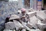 smoothing rocks and boulders, man, hammer, Al Hajjara, Yemen