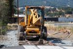 Front Loader, wheeled tractor, Laying down new Rails, 2014, Construction for the new SMART train, ICRD01_028