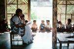 Teacher reading to the children, Schoolroom, Sevagram, India, 1984, 1980s