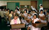 Teacher, Schoolgirls, Schoolboys, desk, tables, chalkboard, desk, classroom
