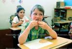 classroom, student, Boy, Male, Guy, cupcake, smiles, eating, Children Eating Lunch, desk, KEDV02P07_02