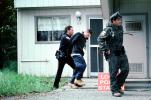 Police arrest a boy, handcuffed, Policeman, Operation Kernel Blitz, urban warfare training, Troops, police