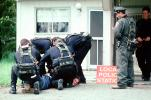 Police arrest a boy, resisting arrest, handcuffed, Policeman, Operation Kernel Blitz, urban warfare training