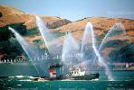 Fireboat Phoenix welcoming the USS Missouri (BB-63), Spraying Water
