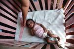 Girl in a crib, newborn, PABV02P03_10