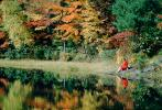 Woman sits over a Reflecting Pond, Fall Colors, New Hampshire, 1950s, autumn, PBAV02P09_19