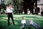 Boys, Lawn, Yawning, Father, Son, 1960s, PCFV03P01_16