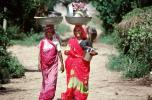Woman Carrying a Balanced Tub on their head, Boral Village, Gujarat, PDCV01P03_05