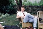 Jim Ritchie, wicker chairs, man, male, backyard, pants, tie, flatop haircut, lawn, 1950s, PDEV01P02_16