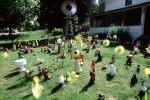 frontyard full of figurines, elfs, cats, mother goose, front yard