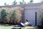Backyard, Lounge Chair, rock garden, wall, man, male, reading, relaxing, PDEV01P05_10