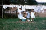 Mother and Daughters hanging laundry to dry, 1950's, PDLV01P10_05