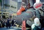 Tom Turkey, Balloon Float, People, Crowds, Macy's Thanksgiving Day Parade, Green Stamps Building, 1971, 1970s, PFPV04P06_07