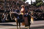 Fat Cowboy, Rider, Rose Parade, backlit tail, horsetail, crowds, January 1961, 1960s, PFPV05P15_12