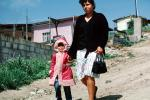 Girl, woman, walking, steep road, hills, Colonia Flores Magone